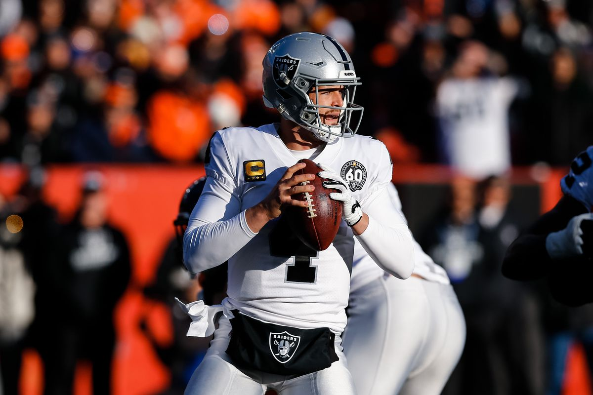 Oakland Raiders quarterback Derek Carr drops back to pass in the second quarter against the Denver Broncos at Empower Field at Mile High.