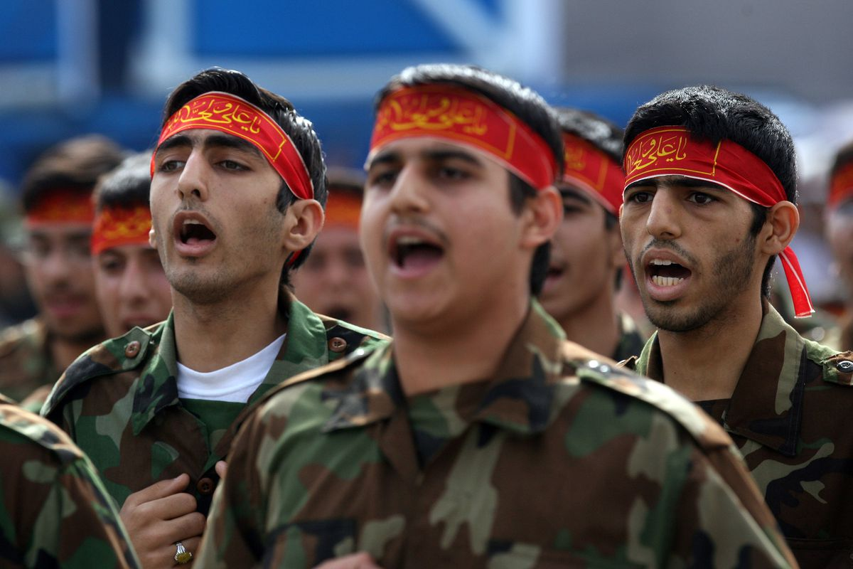 Iranian soldiers march past former Iranian President Mahmoud Ahmadinejad during the annual army day military parade on April 17, 2008 in Tehran, Iran.