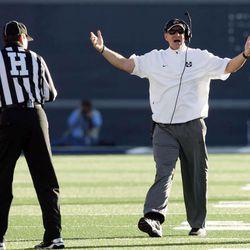 FILE -- Utah State Aggies head coach Gary Andersen protests a call in Logan Saturday, Nov. 24, 2012. Andersen left the Aggies to become the head coach at Wisconsin after the 2012 season.