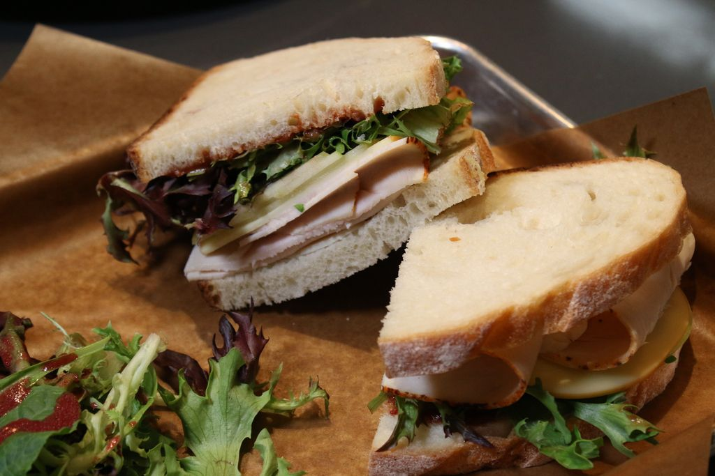 The turkey, apple & gouda sandwich, served atBlackberry Market, is made with sliced turkey, apples, and gouda cheese with chutney and greens.