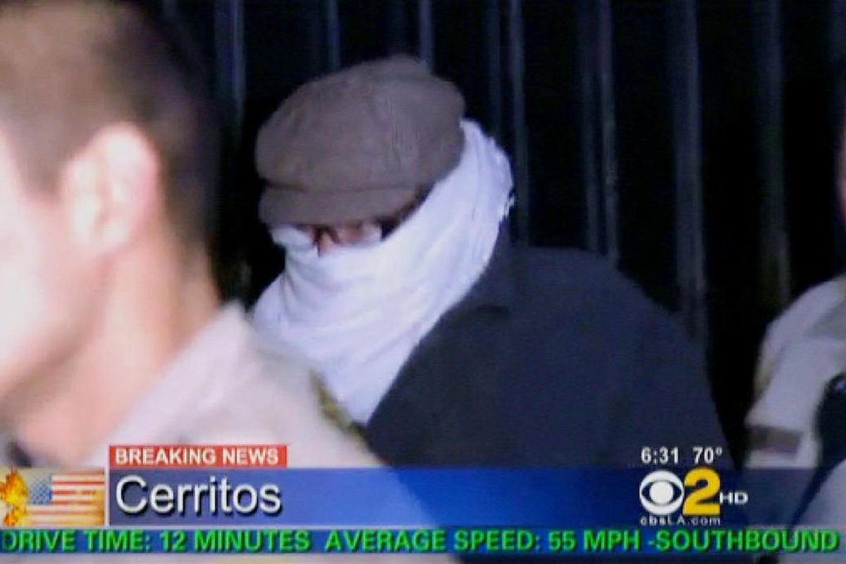 In this image from video provided by CBS2-KCAL9, Nakoula Basseley Nakoula, the man behind the anti-Muslim movie that has inflamed the Middle East, is escorted by Los Angeles County sheriff's deputies from his home, early Saturday, Sept. 15, 2012, in Cerri