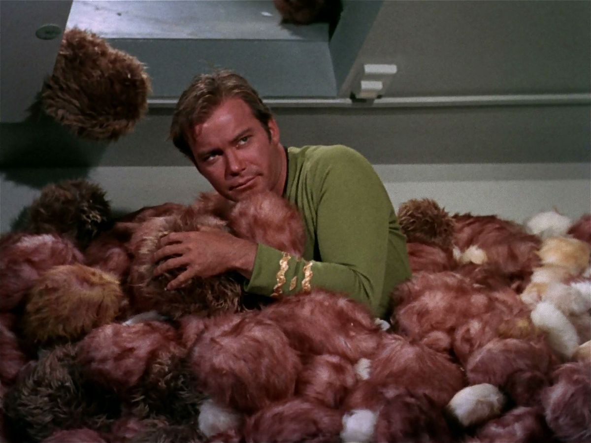 Captain Kirk buried in a pile of Tribbles