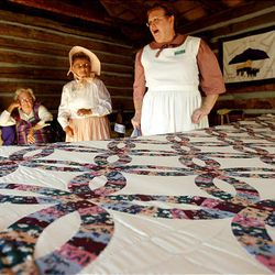 Zoloma Goodall, left, Dawn Warenski and Linda Quitner helped in the restoration of the Daughters of the Utah Pioneers' recently refurbished historic cabin in Santaquin.