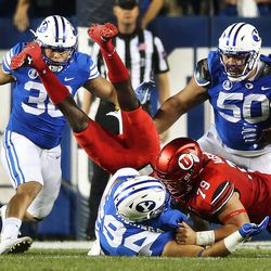 Utah Utes quarterback Tyler Huntley (1) dives for the end zone but comes up short against the Brigham Young Cougars defense in Provo on Saturday, Sept. 9, 2017.