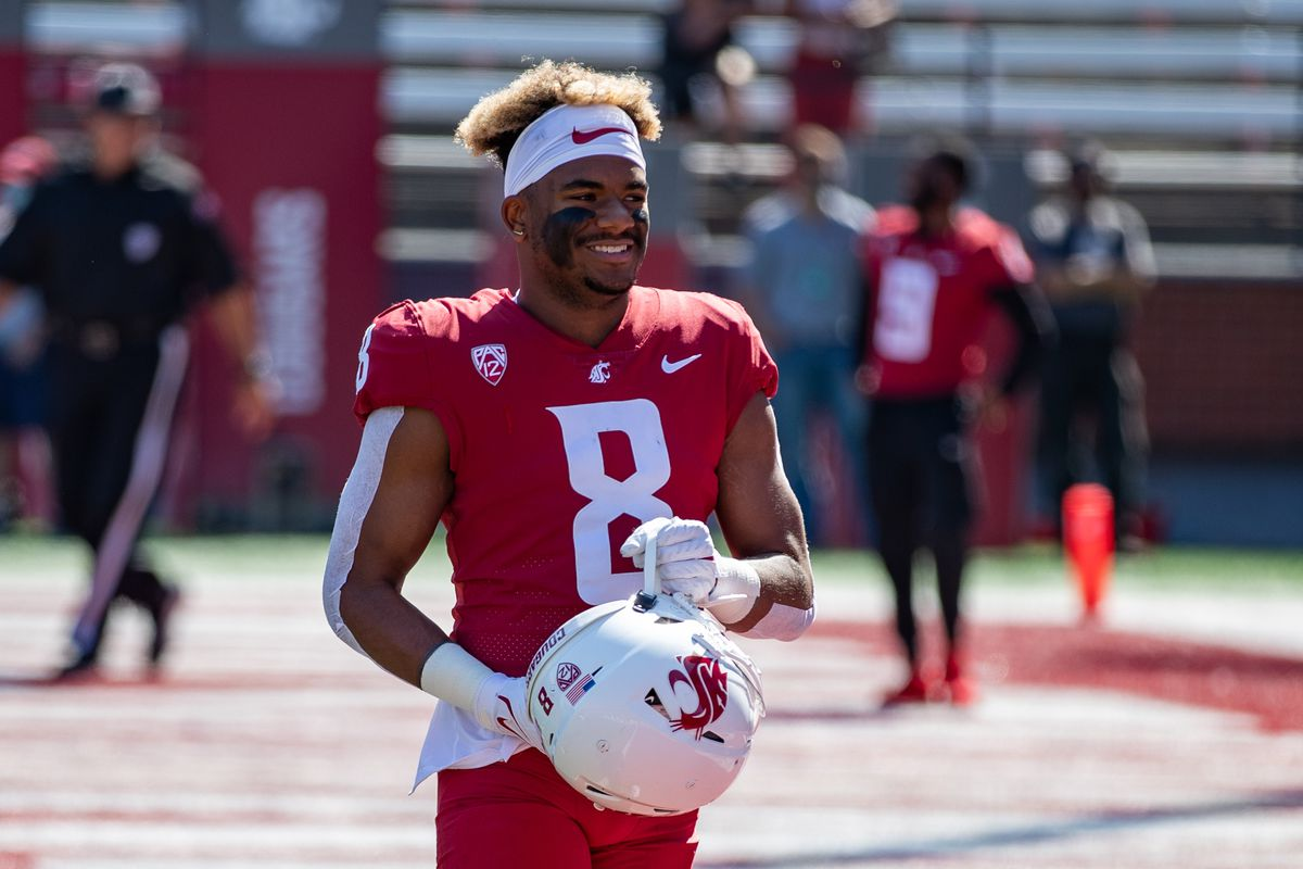 PULLMAN, WA - SEPTEMBER 11: Washington State wide receiver Calvin Jackson Jr (8) smiles prior to a non-conference matchup between the Portland State Vikings and the Washington State Cougars on September 11, 2021, at Martin Stadium in Pullman, WA.