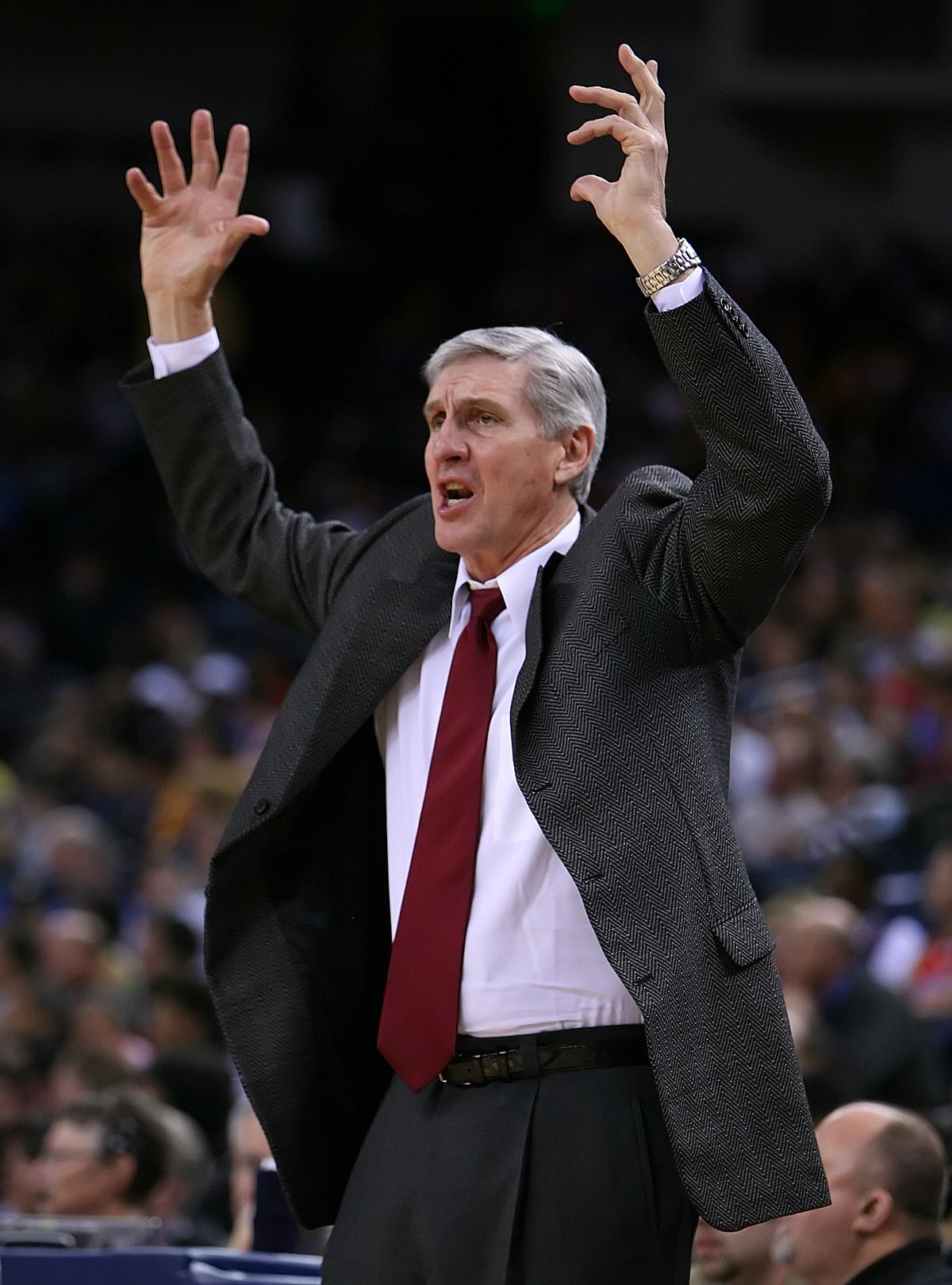 Utah Jazz's head coach Jerry Sloan argues a foul called against his player Jarron Collins, #31, while playing against the Golden State Warriors in the 1st quarter of their game on Monday, February 27, 2006 at The Arena in Oakland, Calif. (Jose Carlos Faja