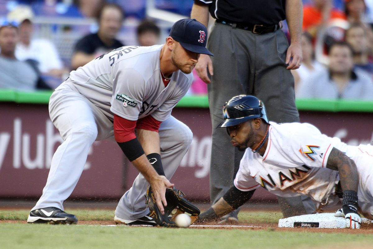 MIAMI, FL - JUNE 12: Jose Reyes #7 of the Miami Marlins slides into third base for a triple against Third Baseman Will Middlebrooks #64 of the Boston Red Sox at Marlins Park on June 12, 2012 in Miami, Florida.  (Photo by Marc Serota/Getty Images)