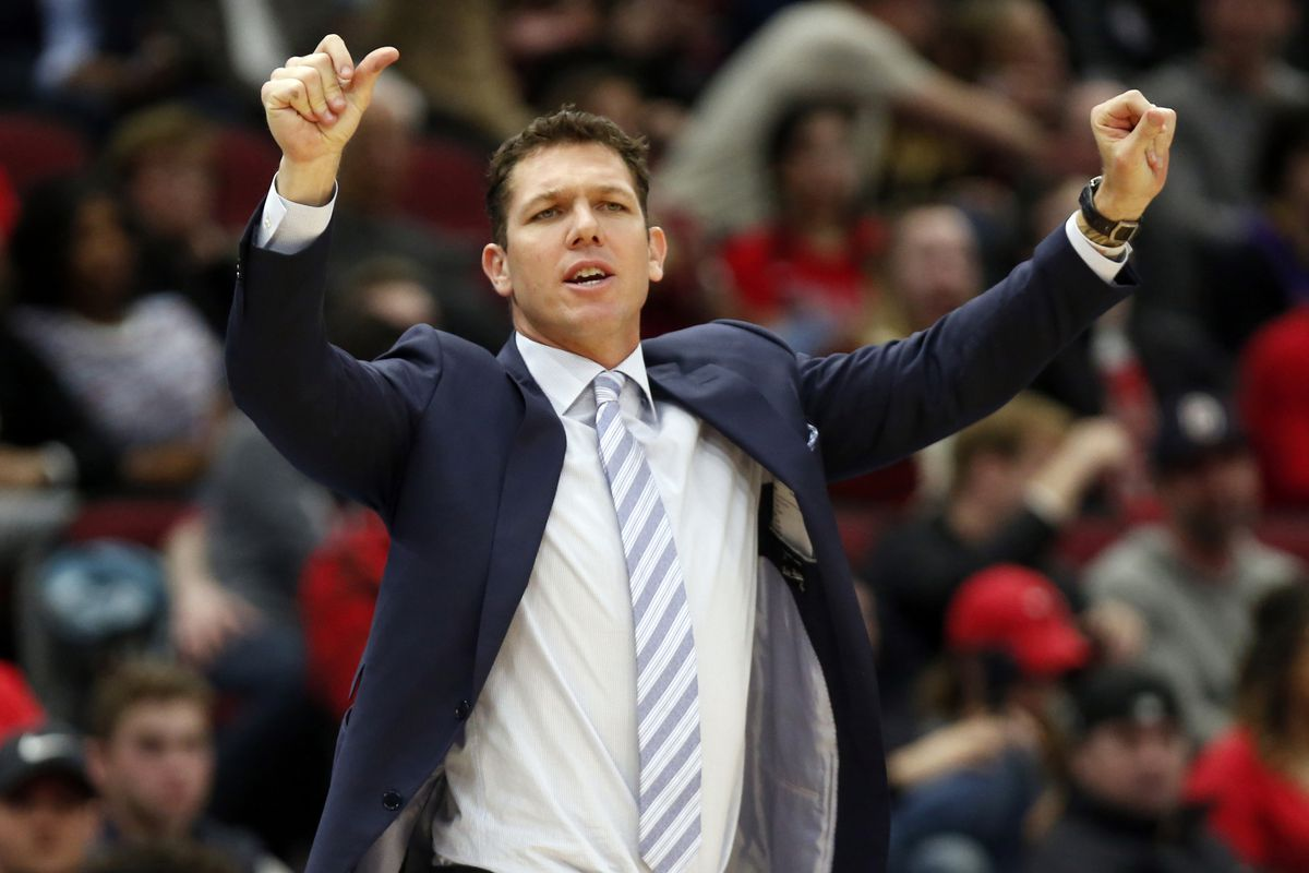 FILE - In this March 12, 2019, file photo, Los Angeles Lakers coach Luke Walton gestures to players during the second half of an NBA basketball game against the Chicago Bulls in Chicago. The Lakers say they have mutually agreed to part ways with Walton af