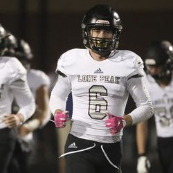 Lone Peak's Nate Ritchie heads back to the bench after kicking a field goal during game at Corner Canyon in Draper on Friday, Sept. 27, 2019.