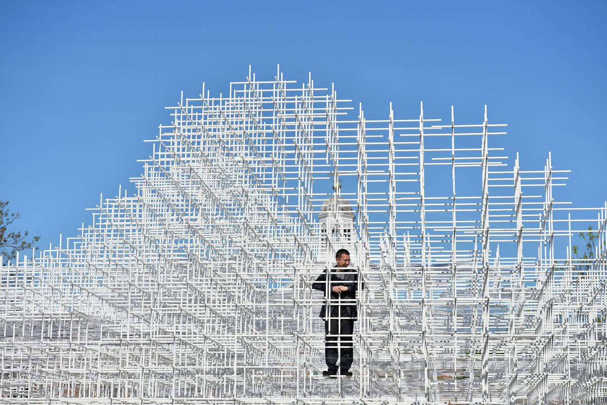 """Sou Fujimoto poses with his Serpentine Pavilion—photo by Ben Stansall/<a href=""""http://www.gettyimages.com/detail/news-photo/japanese-architect-sou-fujimoto-poses-for-photographers-news-photo/169897864"""">Getty</a>"""
