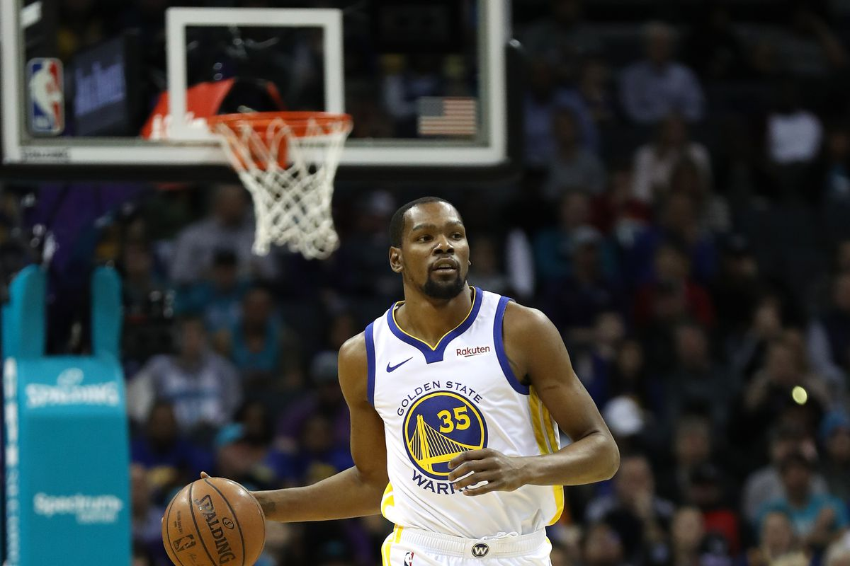 Kevin Durant dribbles the ball during a Golden State Warriors basketball game.