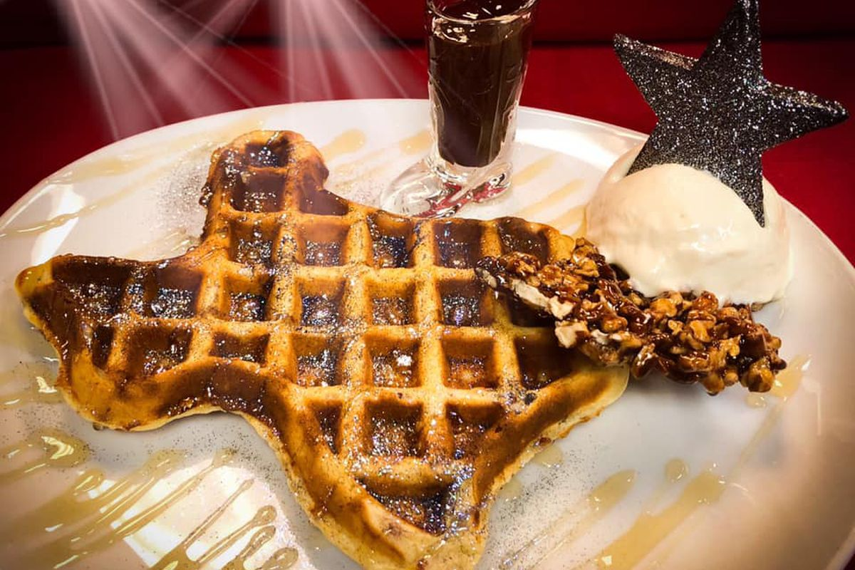 A Texas-shaped waffle served with scoop of ice cream and jalapeno chocolate ganache