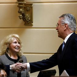 President Dieter F. Uchtdorf second counselor in the First Presidency of the Church of Jesus Christ of Latter-day Saints greets legislators and Utah State workers prior to saying the opening prayer at the start of the 2009 session of the Utah Legislature at the Capitol building in Salt Lake City, Monday.