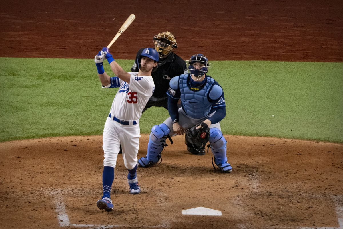 Los Angeles Dodgers center fielder Cody Bellinger (35) hits a two run home run against the Tampa Bay Rays during the fourth inning in game one of the 2020 World Series at Globe Life Field.