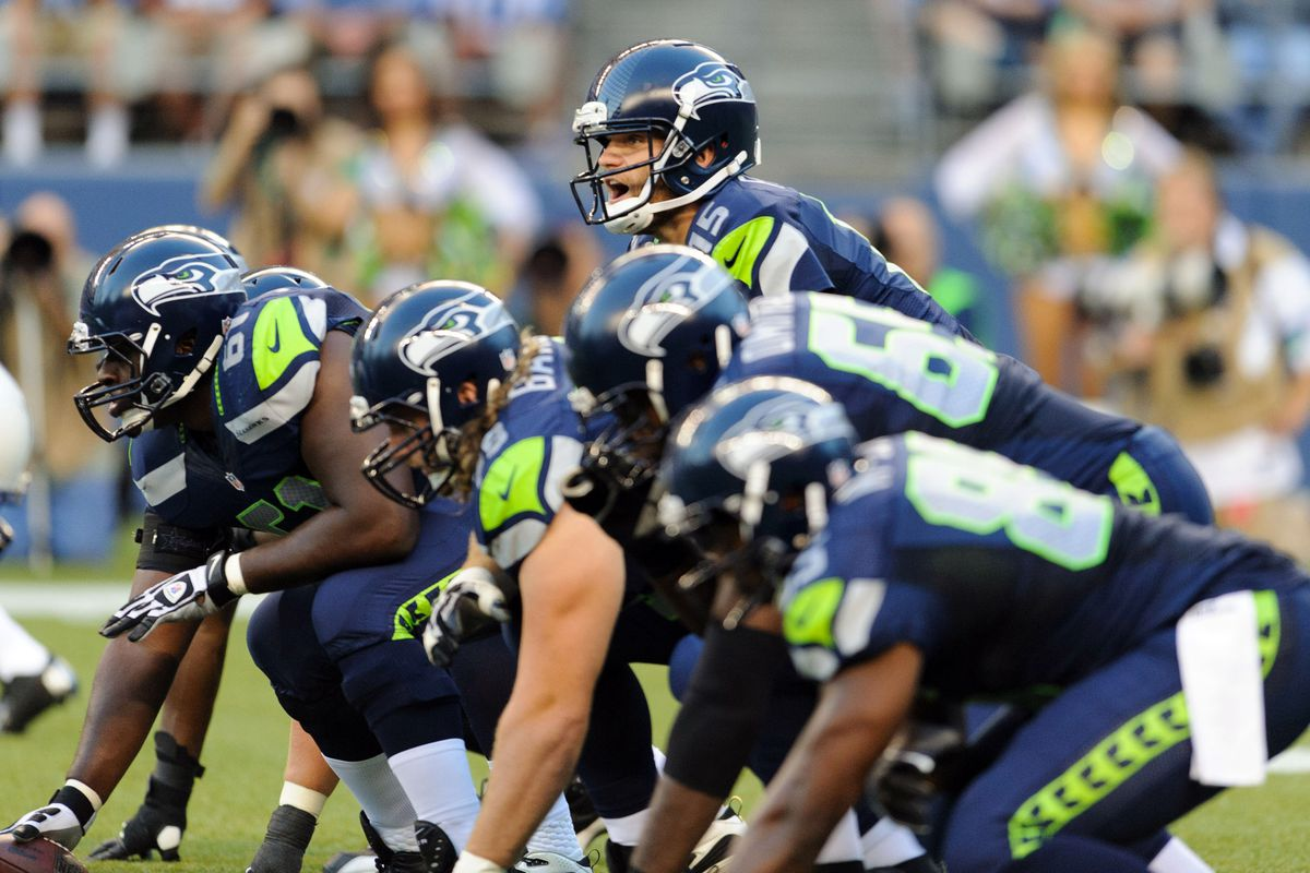 Aug 11, 2012; Seattle, WA, USA; Seattle Seahawks quarterback Matt Flynn (15) calls out plays at the line during the 1st half against the Tennessee Titans at CenturyLink Field. Mandatory Credit: Steven Bisig-US PRESSWIRE