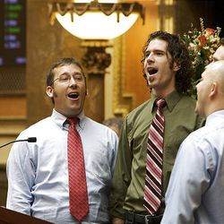"""The barbershop quartet , Rimson 4 from left, Andrew Neff, Ricky Parkinson, Issac Bickmore and David Gray sing """"Utah Man"""" at the start of the 2009 session of the Utah Legislature at the Capitol building in Salt Lake City, Monday."""