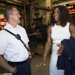 2012 U.S. Open Women's Singles champion Serena Williams speaks with Fire Chief John Hodgens during a visit to the Engine 54 Ladder 4 Battalion 9 firehouse in midtown, Monday, Sept. 10, 2012, in New York. This year alone, Williams claimed the U.S. Open trophy  alongside the gold medals she won at the London Olympics and the silver plate she took home from Wimbledon.