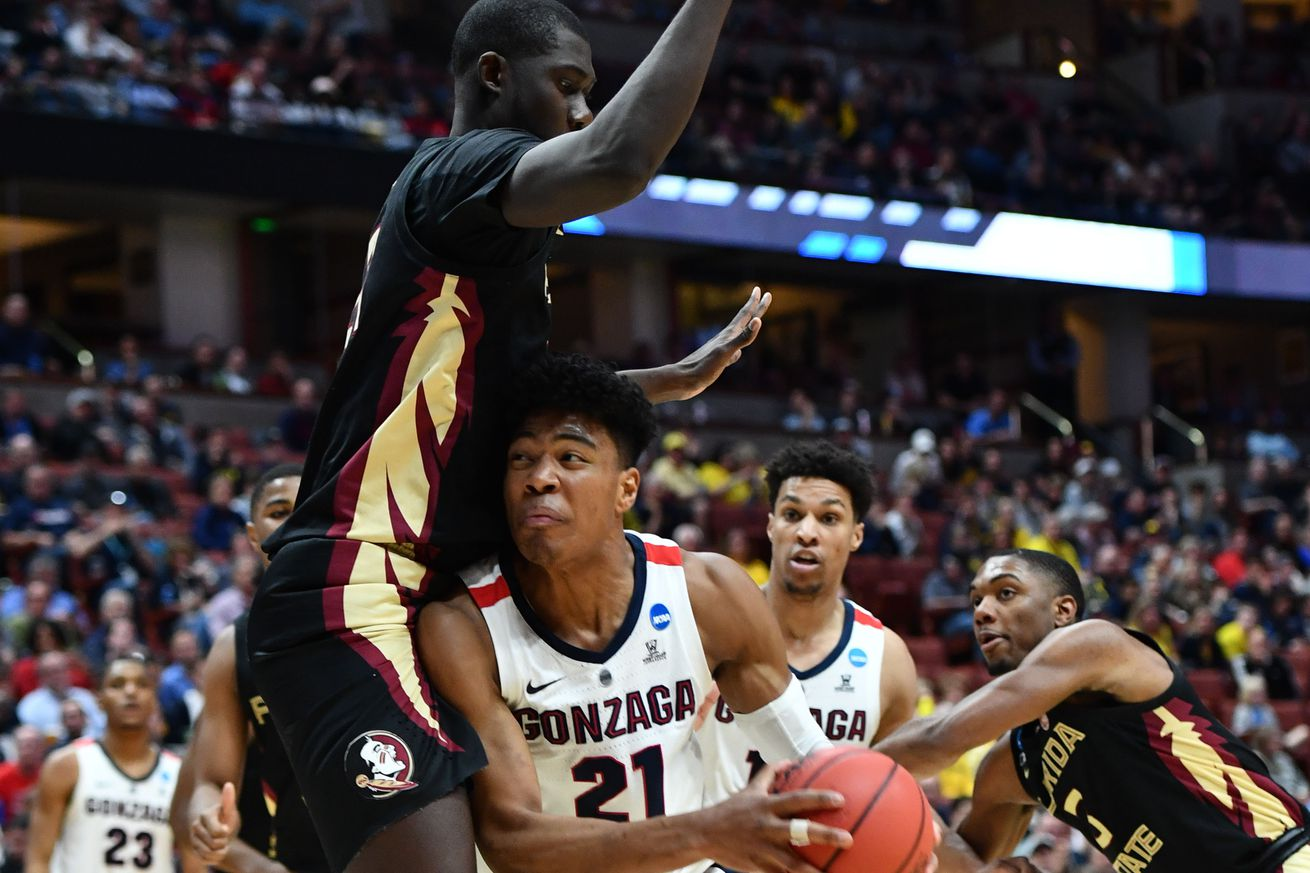 Rui Hachimura draws a foul on 7-foot-4 center Christ Koumadje.