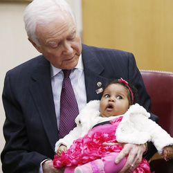 Sen. Orrin Hatch holds Aisha Keyembe in his office in Salt Lake City on Feb. 18, 2016. Hatch helped resolve a visa issue allowing Kayembe's mother to join her father in the United States.
