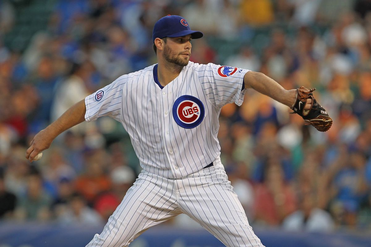 Starting pitcher Randy Wells of the Chicago Cubs delivers the ball against the Atlanta Braves at Wrigley Field in Chicago, Illinois. (Photo by Jonathan Daniel/Getty Images)