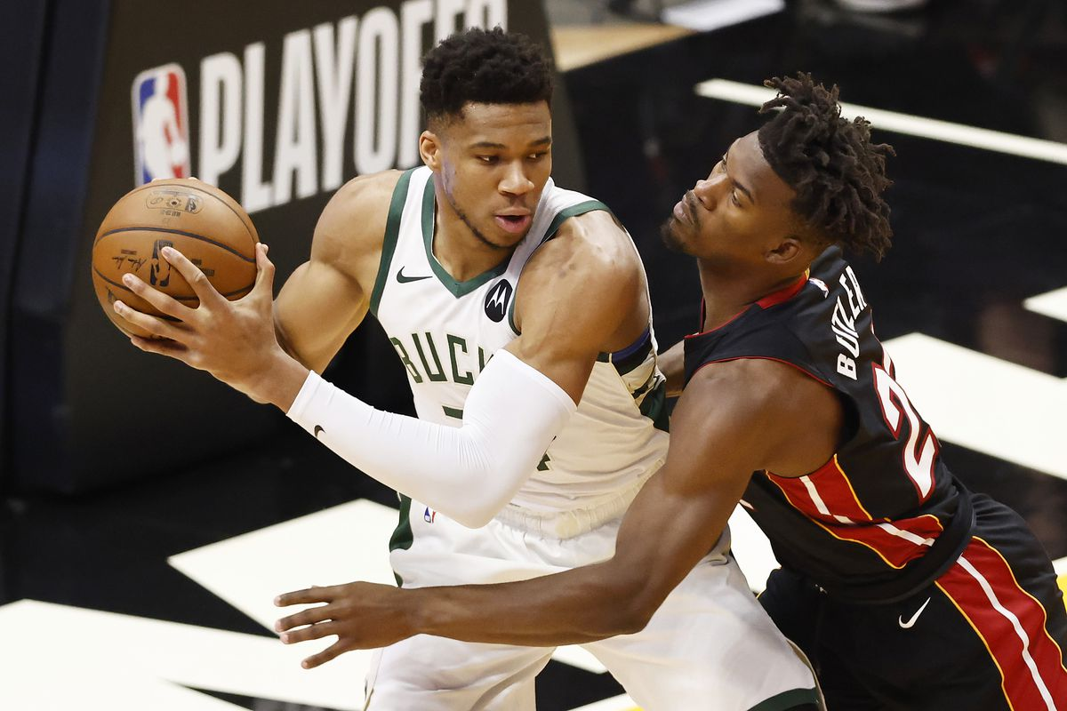 Giannis Antetokounmpo #34 of the Milwaukee Bucks is defended by Jimmy Butler #22 of the Miami Heat during the first quarter in Game Three of the Eastern Conference first-round playoff series at American Airlines Arena on May 27, 2021 in Miami, Florida.