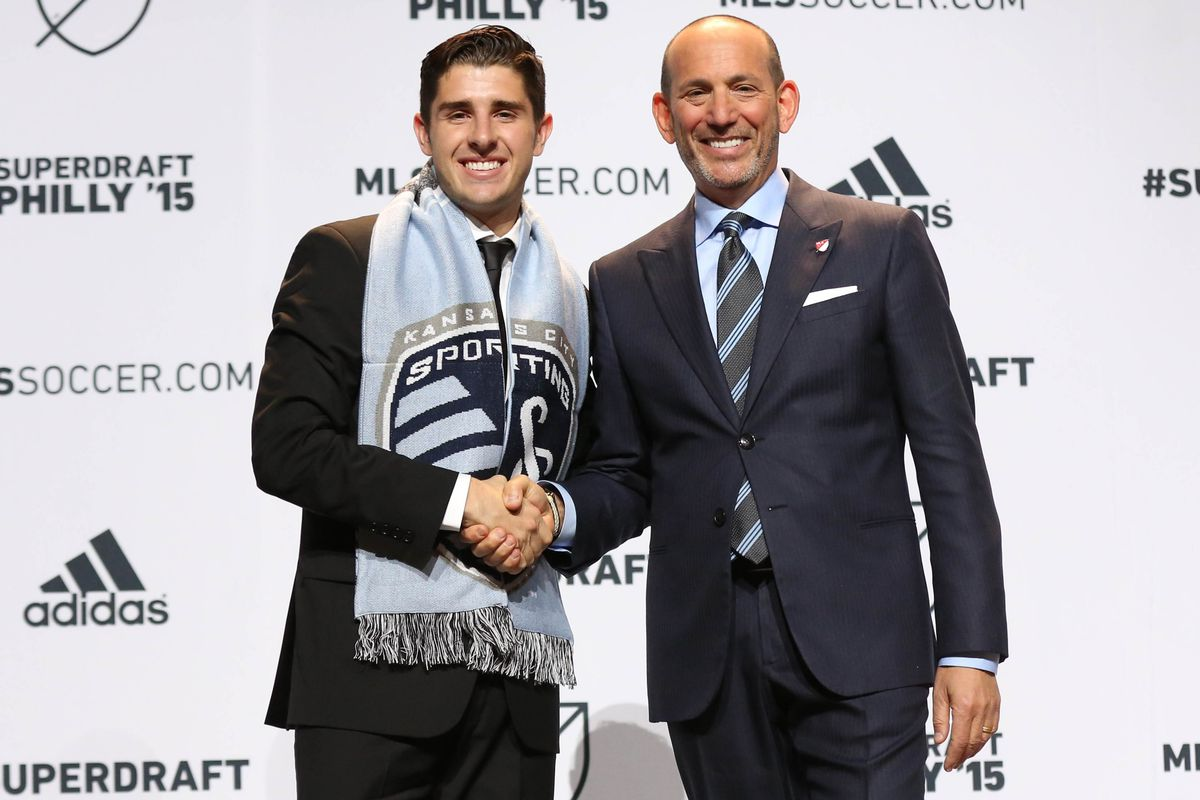 Sporting KC's first pickConnor Hallisey, shakes hands with Don Garber