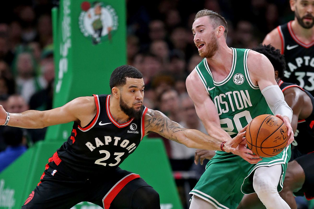 BOSTON MA. - OCTOBER 25: Fred VanVleet #23 of the Toronto Raptors gets a hand on the ball of Gordon Hayward #20 of the Boston Celtics as the Celtics take on the Raptors at the Garden on October 25, 2019 in Boston, MA. (Staff Photo By Stuart Cahill/MediaN