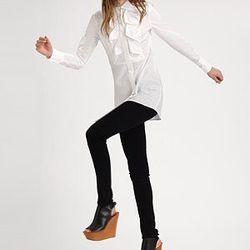 "<a href= ""http://www.saksfifthavenue.com/main/ProductDetail.jsp?PRODUCT%3C%3Eprd_id=845524446480103&FOLDER%3C%3Efolder_id=282574492827505&bmUID=jsb5C8s&esre=fshnstrepisode8pdp1"">Fashion Star Collared Shirt by Kara Laricks</a>, $235 at Saks"