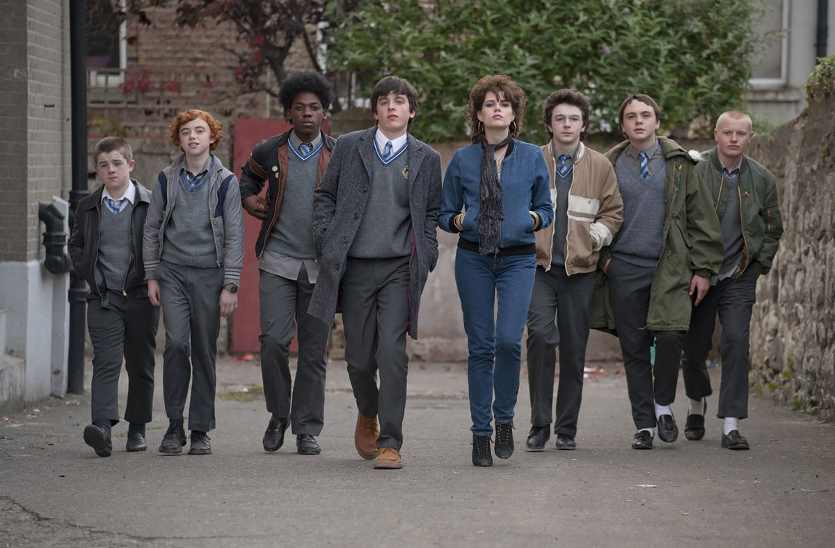 """The cast of """"Sing Street"""" strides down the road."""