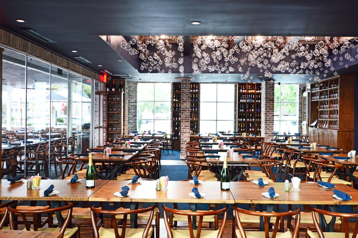 An Artsy Installation Of Nearly 1000 Glass Bubbles Hangs From The Center Main Dining Room And Bottles Champagne Anchor Just About Every Surface