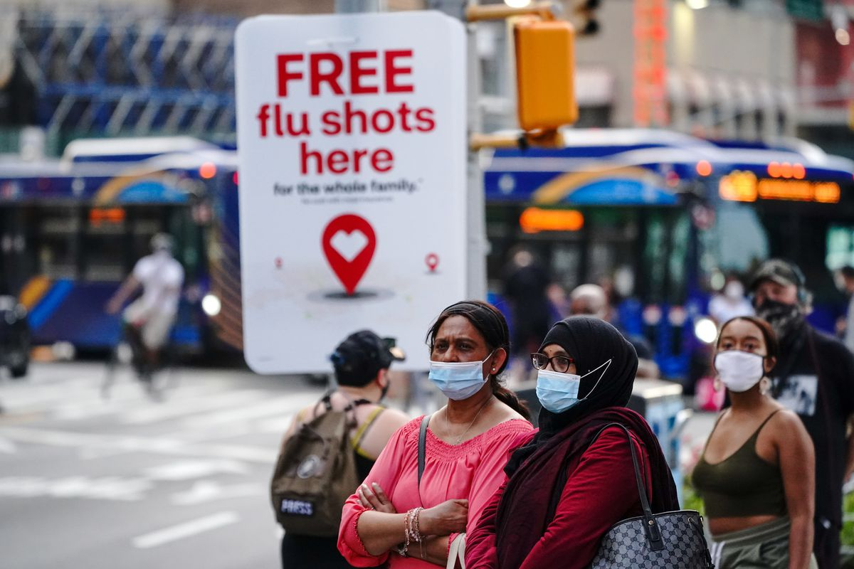 An advertisement offering free flu shots is seen during the...