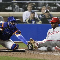 New York Mets catcher Kelly Shoppach tags out Philadelphia Phillies' Domonic Brown during the fifth inning of a baseball game Thursday, Sept. 20, 2012, in New York.