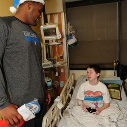 Glen Davis visits children at the Walt Disney Pavilion at Florida Hospital for Children
