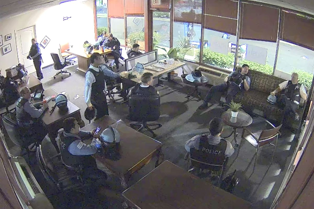 This still image taken from security video released by the Congressman Bobby Rush's Campaign Office shows Chicago police inside Rush's burglarized congressional campaign office at 5401. S. Wentworth. The police and supervisors appeared to be making popcorn and brewing coffee as people vandalized and stole from nearby businesses during unrest that spread across the city