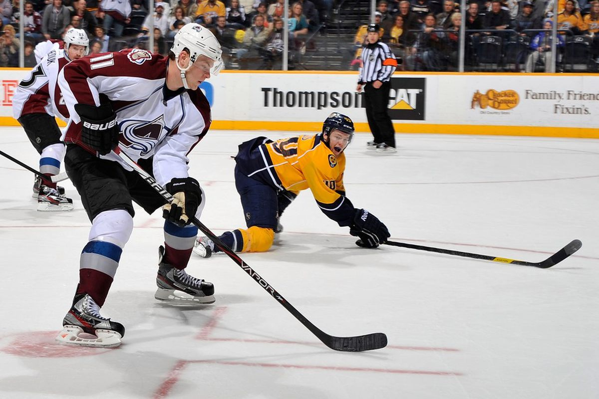 NASHVILLE, TN - MARCH 08:  Ryan Ellis #49 of the Nashville Predators goes down to block the shot of Jamie McGinn #11 of the Colorado Avalanche at Bridgestone Arena on March 8, 2012 in Nashville, Tennessee.  (Photo by Frederick Breedon/Getty Images)