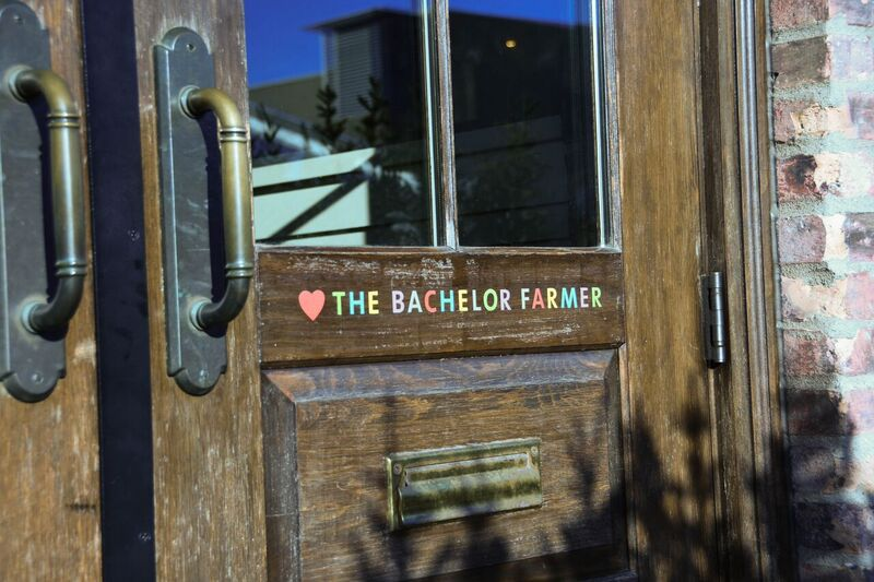 The front door of The Bachelor Farmer, the multicolored name with a signature heart