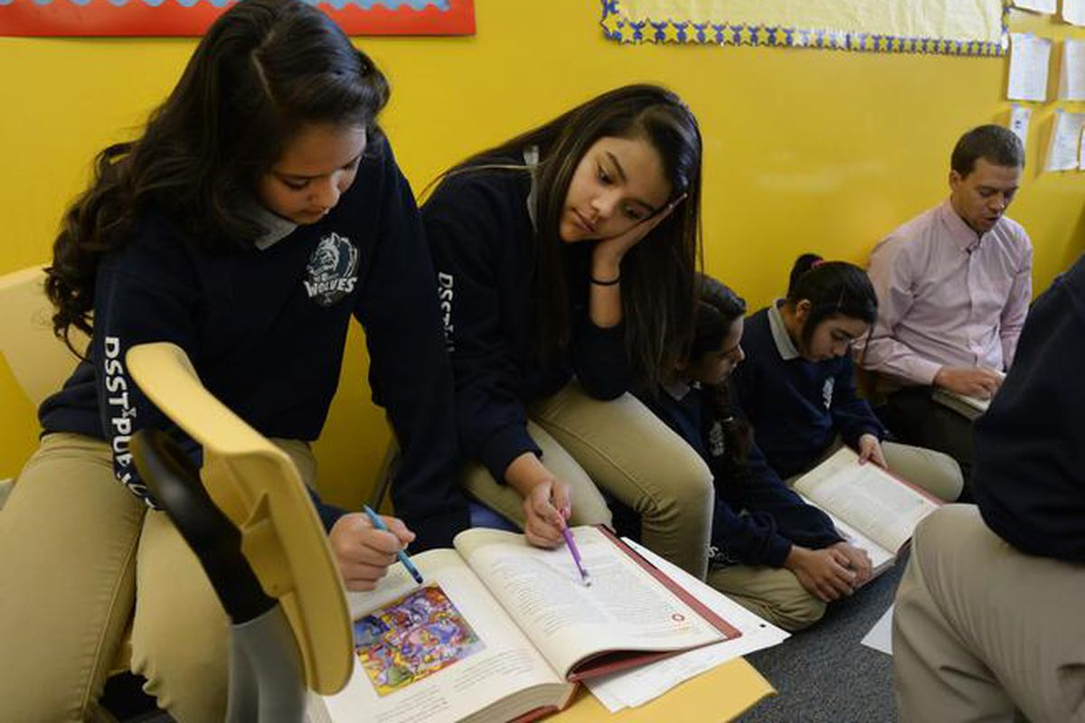 Students at DSST: College View Middle School work on a reading assignment during an English Language Development class.