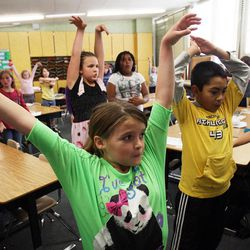 Abbey Neilson, front, and Daniel Berroteran, front right, exercise in Nicole Carter's class at Tolman Elementary School in Bountiful, Monday, Nov. 26, 2012.