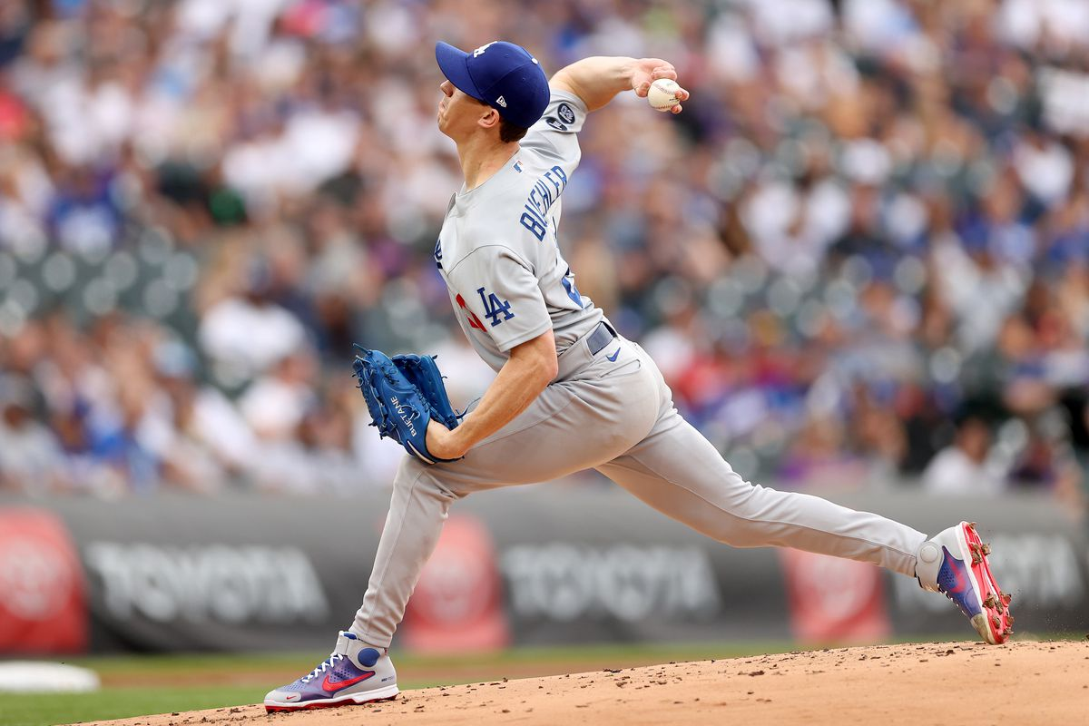 Starting pitcher Walker Buehler #21 of the Los Angeles Dodgers throws against the Colorado Rockies in the first inning at Coors Field on July 17, 2021 in Denver, Colorado.