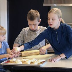 Penny, left, Henry and Ellie White make Thanksgiving rolls in the kitchen of their home in Holladay on Wednesday, Nov. 25, 2020. The family started a bakery two years ago and has been baking loaves of bread every week, fulfilling neighbors' orders. This year, the family is donating proceeds from Thanksgiving roll sales to foster care agency Brighter Futures to help pay for kids' Christmas presents after Utah and Salt Lake counties notified the agency they can't give it funding for gifts this year.