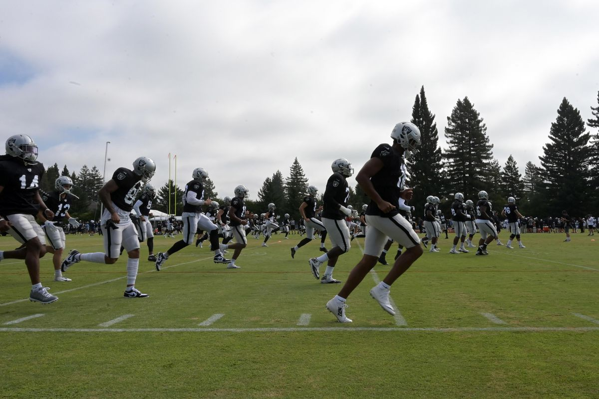 General overall view as Oakland Raiders players warmup during a training camp joint practice against the Los Angeles Rams at Napa Valley Marriott.