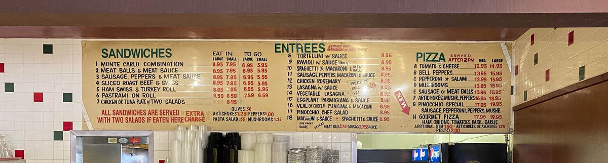 A hand-painted menu board showing Italian specialities.