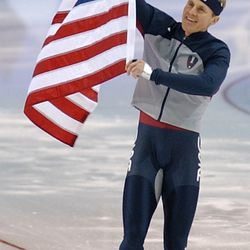 USA's Casey Fitzrandolph holds a American flag after the second day of men's racing in the 500 meter on Feb. 12, 2002. Fitzrandolph won the gold.