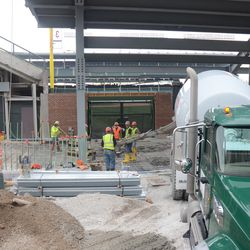 2:11 p.m. Concrete being poured at Gate Q -
