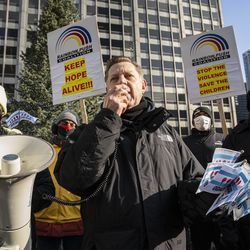 The Rev. Michael Pfleger speaks to the crowd protesting Chicago violence.