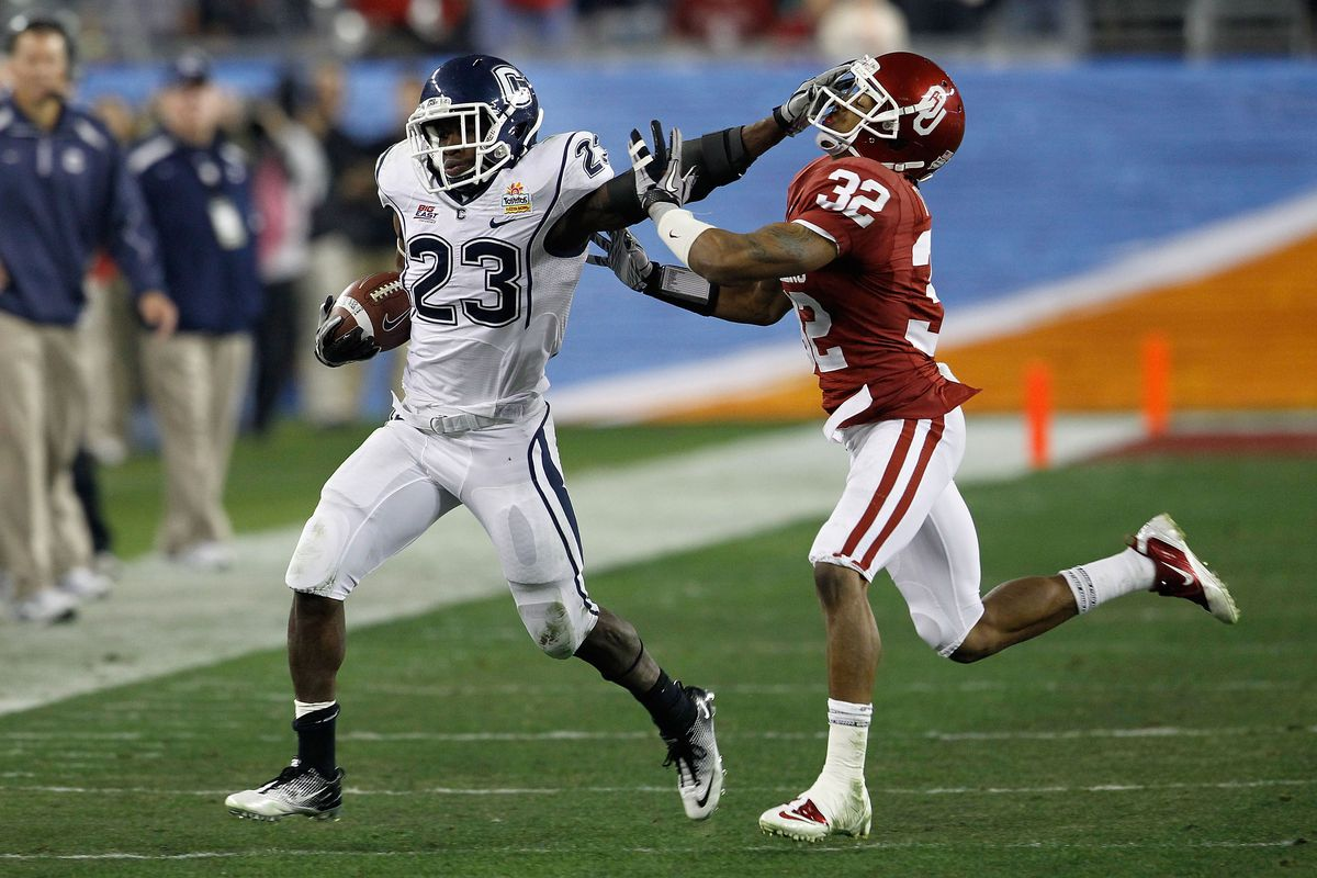 Jordan Todman stiff arms an Oklahoma defender while making a run during the 2011 Fiesta Bowl.