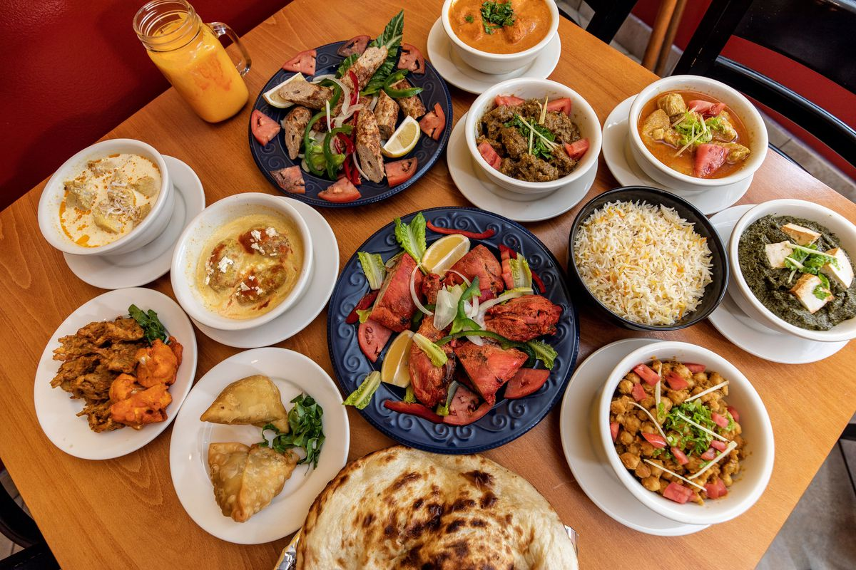 table full of indian dishes