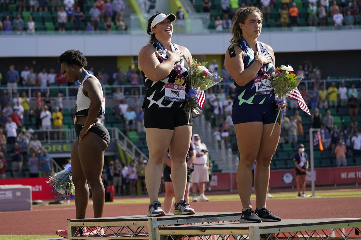 Gwendolyn Berry, left, looks away as others stand for the national anthem at the U.S. Olympic Track and Field Trials.