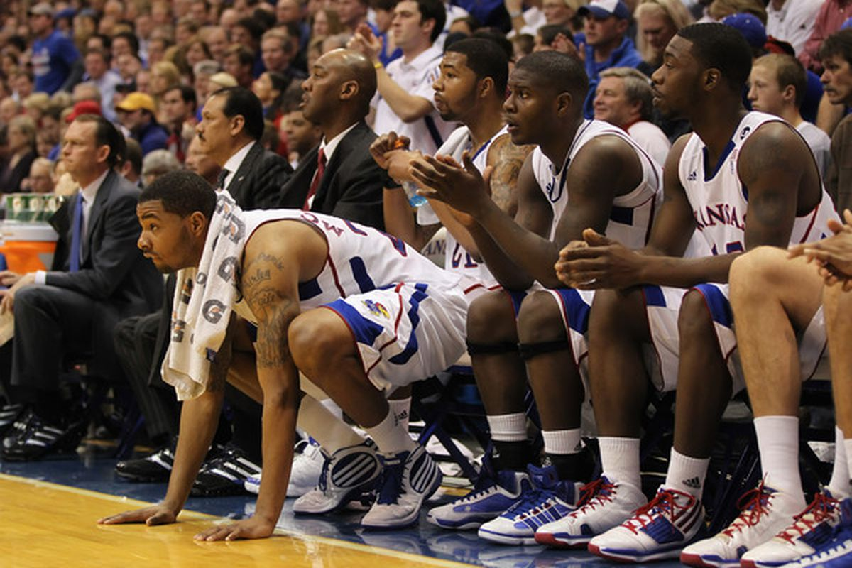 LAWRENCE KS - JANUARY 29:  Marcus Morris #22 of the Kansas Jayhawks and teammates cheer from the bench during the game against the Kansas State Wildcats on January 29 2011 at Allen Fieldhouse in Lawrence Kansas.  (Photo by Jamie Squire/Getty Images)