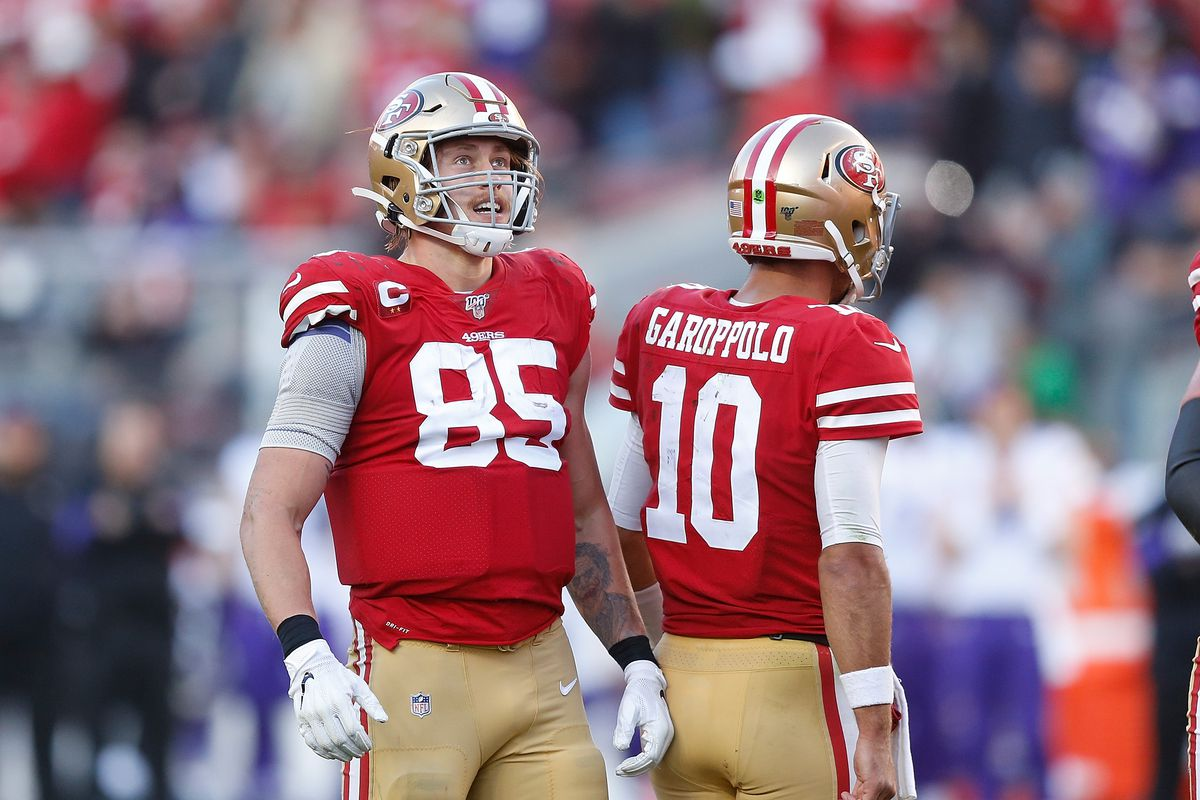 George Kittle and quarterback Jimmy Garoppolo of the San Francisco 49ers react after a play in the third quarter of the NFC Divisional Round Playoff game against the Minnesota Vikings at Levi's Stadium on January 11, 2020 in Santa Clara, California.